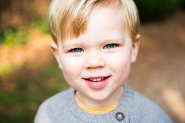 blonde boy with blue eyes looking into the camera