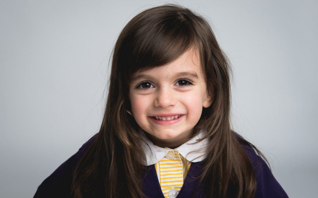 pre-school photo of smiling girl